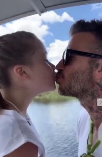 贝克汉姆亲吻小七引争议 父爱方式怎样才是个度?